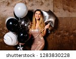excited pretty woman with... | Shutterstock . vector #1283830228