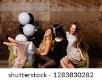party mood. three happy female... | Shutterstock . vector #1283830282