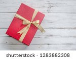 gift box with red bow ribbon... | Shutterstock . vector #1283882308