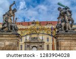 Small photo of Statue of Battling Titan over the front gate of Hradcany Castle in Prague (Praha), Czech Republic