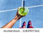 healthy detox green smoothie... | Shutterstock . vector #1283907262