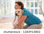mid adult woman kneeling with... | Shutterstock . vector #1283913802