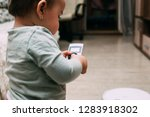 the child controls the robot... | Shutterstock . vector #1283918302