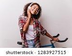 pleasant black girl enjoying... | Shutterstock . vector #1283927515