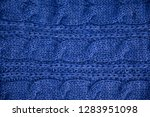 stack of warm knitwear close up....   Shutterstock . vector #1283951098