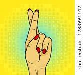 hand showing fingers crossed.... | Shutterstock .eps vector #1283991142