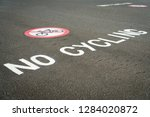 no cycling sign on pavement... | Shutterstock . vector #1284020872
