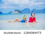 cute happy girl and boy with...   Shutterstock . vector #1284084475