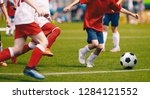 children play soccer game.... | Shutterstock . vector #1284121552