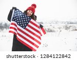 young smiling woman in red hat...   Shutterstock . vector #1284122842