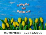 spring is coming text. tulips... | Shutterstock . vector #1284122902