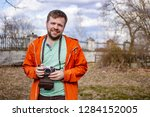 happy smiling photographer... | Shutterstock . vector #1284152005