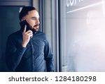 caucasian businessman talking... | Shutterstock . vector #1284180298