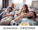friends watching football game...   Shutterstock . vector #1284225868