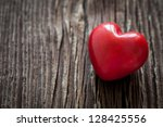 heart shape on wooden background - stock photo