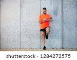 young bearded man standing... | Shutterstock . vector #1284272575