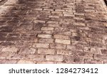 detail of a paved street in... | Shutterstock . vector #1284273412
