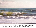 autumn stormy sea on a sunny... | Shutterstock . vector #1284306595