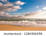 autumn stormy sea on a sunny... | Shutterstock . vector #1284306598