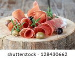prosciutto with olives and... | Shutterstock . vector #128430662