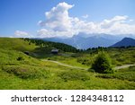 green alpine meadows in the... | Shutterstock . vector #1284348112