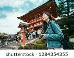 asian girl traveler holding... | Shutterstock . vector #1284354355