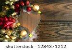 wood heart gift background.... | Shutterstock . vector #1284371212