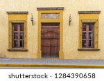 front of colorful mexican house ... | Shutterstock . vector #1284390658