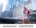 happy beautiful asian woman in... | Shutterstock . vector #1284393205
