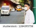 a man wearing mouth mask... | Shutterstock . vector #1284395758