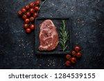 food background. raw rib eye... | Shutterstock . vector #1284539155