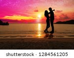 silhouette happy young couple... | Shutterstock . vector #1284561205