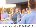 business colleagues toasting...   Shutterstock . vector #1284566812