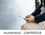businessman using a smartphone...   Shutterstock . vector #1284583018