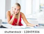 in the library   pretty female... | Shutterstock . vector #128459306