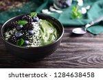 tasty spirulina smoothie with... | Shutterstock . vector #1284638458