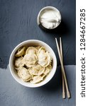 cooked dumplings are served in... | Shutterstock . vector #1284667285