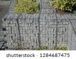 modern gabion fence wall with... | Shutterstock . vector #1284687475