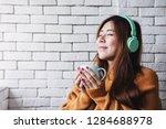 young woman listening music... | Shutterstock . vector #1284688978