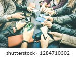 Stock photo people hands having addicted fun together using smartphone millenial sharing content on social 1284710302