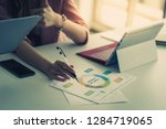 business woman is working on... | Shutterstock . vector #1284719065