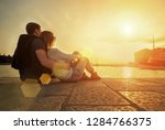 happy couple of lovers relaxing ... | Shutterstock . vector #1284766375