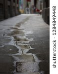 puddle on the cobbled street ...   Shutterstock . vector #1284849448