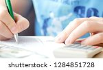 man counting dollars and...   Shutterstock . vector #1284851728