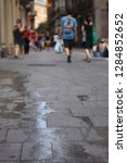 puddle on the cobbled street ...   Shutterstock . vector #1284852652