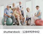group of active seniors sitting ... | Shutterstock . vector #1284909442
