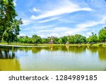 buddha statue at wat mahathat... | Shutterstock . vector #1284989185