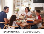 young hispanic family sitting... | Shutterstock . vector #1284992698