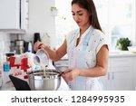 millennial hispanic woman... | Shutterstock . vector #1284995935