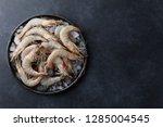 fresh tiger prawns in a plate... | Shutterstock . vector #1285004545